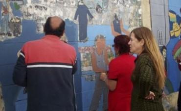 Villa Pueyrredón comenzó a restaurar los murales de la ex fábrica Grafa
